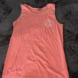 A pink sleeve less shirt from Comfort colors